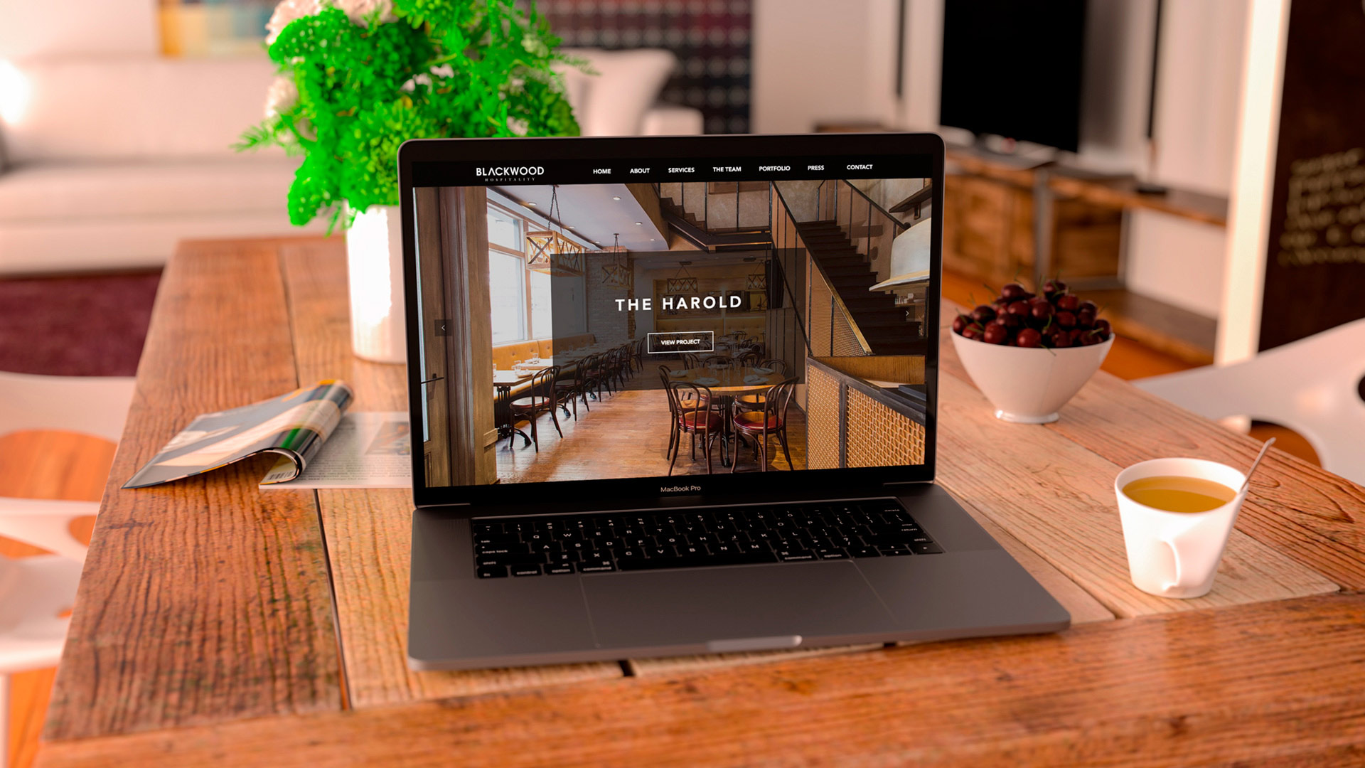Blackwood Hospitality website design laptop in kitchen
