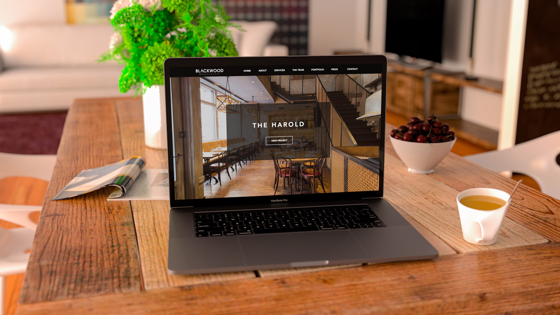 Black laptop in living room mockup website design