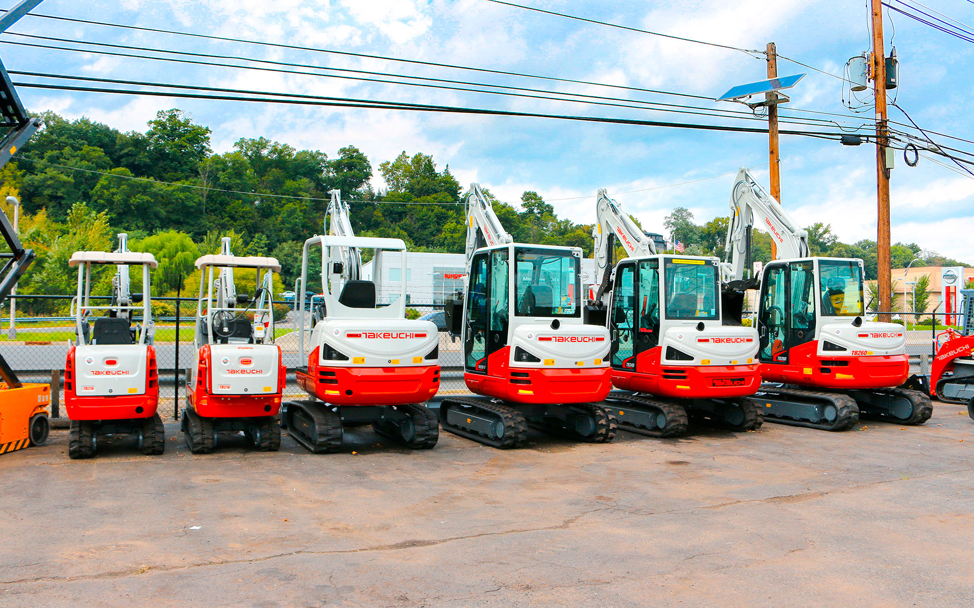 Row of Takeuchi Excavators small to big