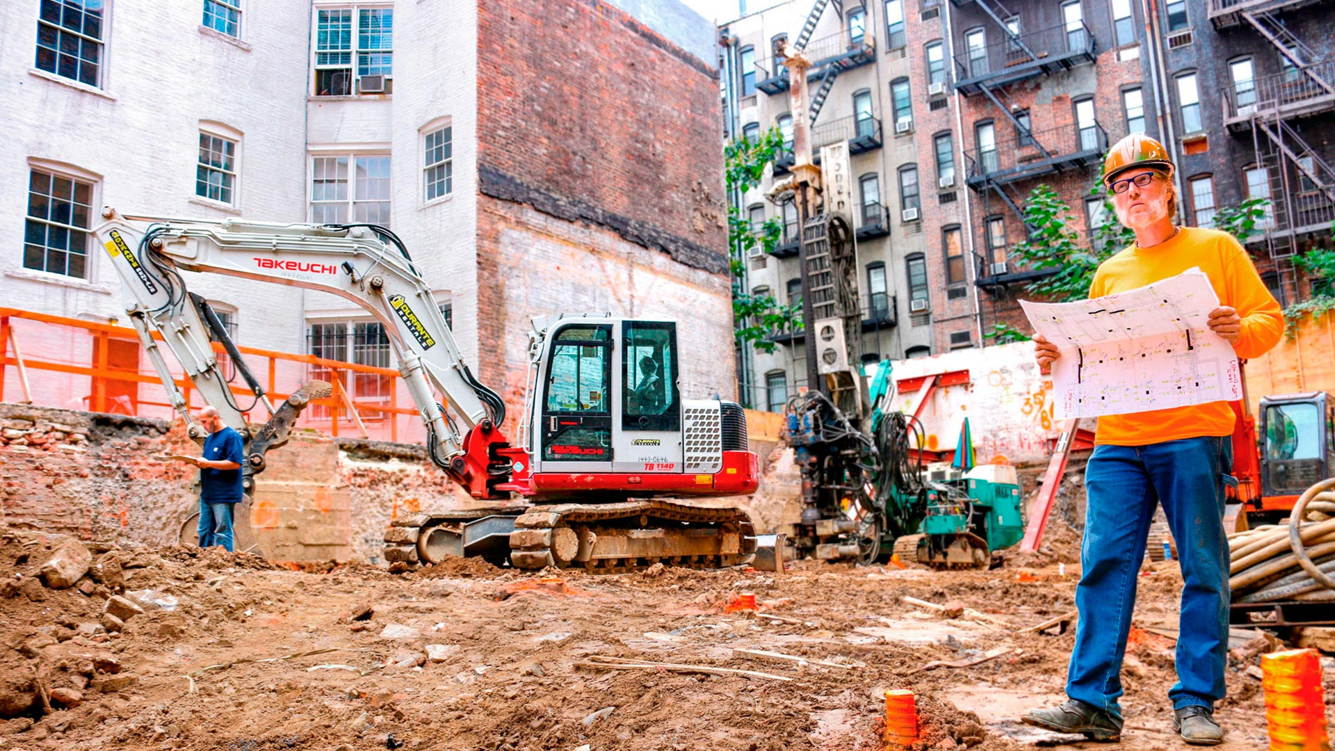 Man on construction site with excavator new york city