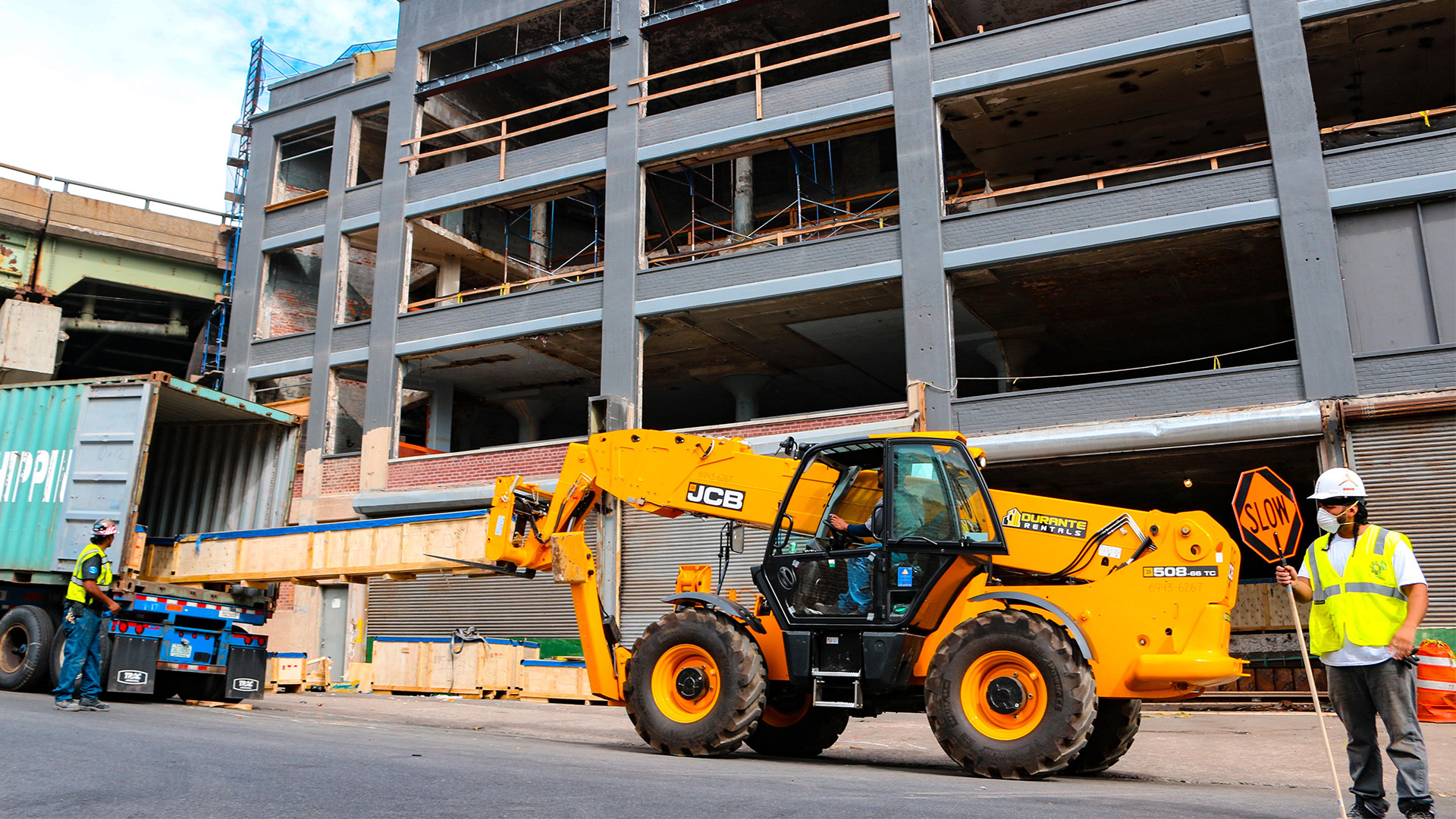 JCB Telehandler in New York City with construction workers
