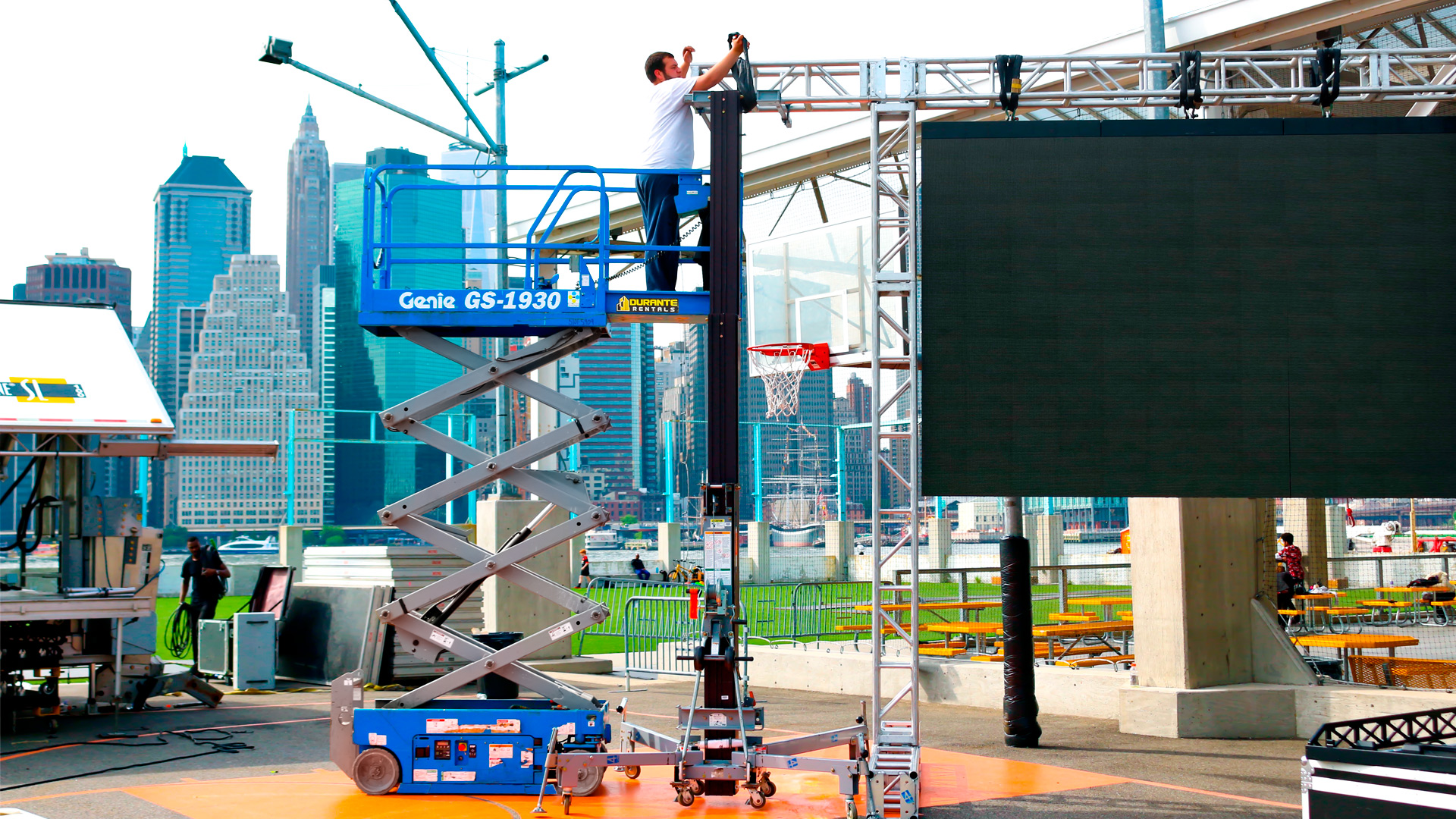 Guy in Genie Scissor Lift at Brooklyn Bridge Park Freedom Tower